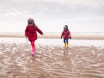 Small boy and girl paddling on the beach Royalty Free Stock Photos