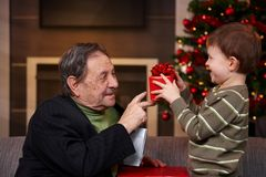 Small boy giving present Royalty Free Stock Images