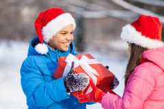 Small boy giving present to girl. Stock Photo