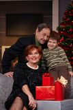 Small boy with grandparents at christmas Stock Photo