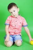 Small boy on green background Royalty Free Stock Photography