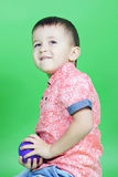 Small boy on green background Stock Photos