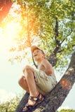 Small boy has fun climbing on the tree Stock Image