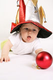 Small boy in the hat of jester Stock Images