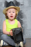 Small boy in hat sits on the floor Royalty Free Stock Photography