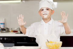Small boy having fun coking in the kitchen Stock Photo