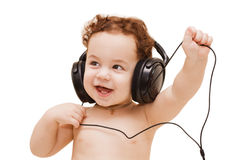 Small boy in headphones. Small boy in big black headphones on white background Stock Photos