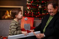 Small boy helping grandfather Royalty Free Stock Photography