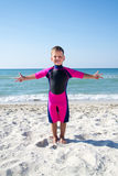Small boy in his diving suit smiling at the beach Stock Images