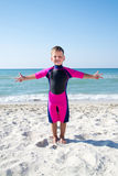Small boy in his diving suit smiling at the beach Stock Photo