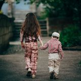 Small boy and his sister go for the walk Royalty Free Stock Image