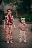 Small boy and his sister go for the walk Stock Image
