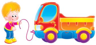Small boy and his toy truck. A small boy plays with his toy truck Royalty Free Stock Images