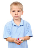 Small boy hold candies in hand Stock Photos