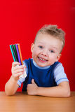 Small boy holding a colorful markers Royalty Free Stock Image