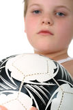 Small boy holding football ball isolated on white Royalty Free Stock Images