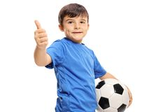 Small boy holding football and making thumb up sign. Small boy in a blue jersey holding a football and making a thumb up sign isolated on white background Stock Image