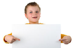 Small boy holds blank billboard isolated on white Royalty Free Stock Photo