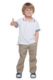 Small boy holds his thumb up Royalty Free Stock Image