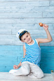Small boy holds a shell Royalty Free Stock Photo