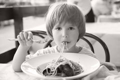 The small boy in italian restaurant Royalty Free Stock Photos