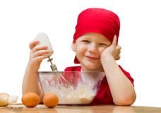 Small boy in kitchen with baking pie, isolated Stock Image