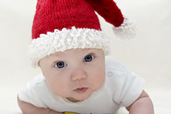Small boy in knitted red hat Stock Images