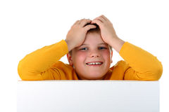 Small boy laughing holding his head isolated Stock Photos