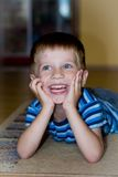 Small boy laughs Stock Photography