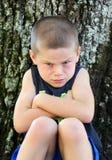 Cross and Upset Little Boy stock photography