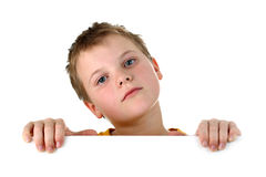 Small boy looking out of whiteboard isolated Stock Photo
