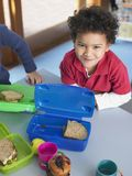 Small Boy With Lunch Box Royalty Free Stock Images