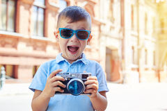 Small boy is making excited face trying to take a shot in the ci Royalty Free Stock Photography