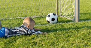 Small boy misses the goal Royalty Free Stock Images