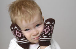 Small boy and mittens. Portrait of small cute boy in winter mittens Stock Image