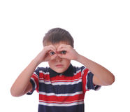 Small boy model holding hands binoculars Stock Photos