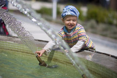 Small boy near fountain Royalty Free Stock Images
