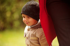 Small Boy near his Mother. Small boy walking in the park close to his mother Stock Image