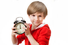 Small boy in new year night. Small boy with alarm clock in new year night Stock Photos