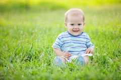 Small boy outdoors in a park Royalty Free Stock Photos