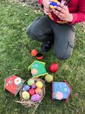 Boy is painting Easter egg at the green garden Stock Photo