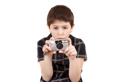 Small boy photographing horizontal with digital camera Royalty Free Stock Images