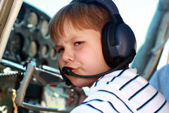Small boy pilot in private aircraft royalty free stock photography
