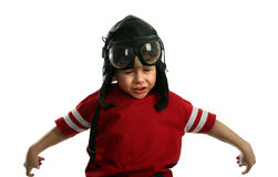 Small boy in the pilot's cap flying Stock Photography