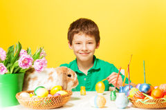 Small boy with plate, Eastern eggs and rabbit Royalty Free Stock Images