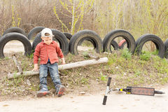 Small boy playing alone in the park Stock Photo