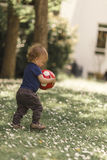 Small boy playing with a ball Stock Photos