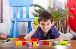 Small boy playing blocks Stock Photo