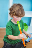 Small boy playing the flute Royalty Free Stock Image
