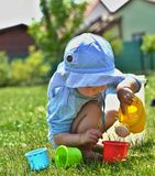 Small boy is playing in the garden Stock Photo